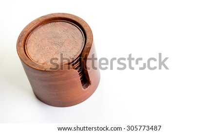 Round shaped wooden coasters or mat holder for cup or glass. Isolated on white background. Slightly de-focused and close-up shot. Copy space.