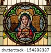 Round stained glass window depicting Immaculate Heart of Mary - stock photo