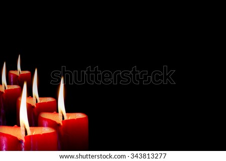 Row of Candle flame in black background