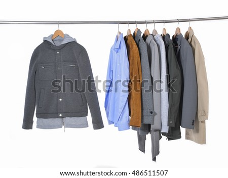 Row of casual men's clothes shirts , coat suit,on hangers