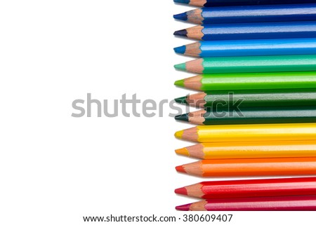 Row of colored pencils. A line of bright and colorful crayons used for drawing.