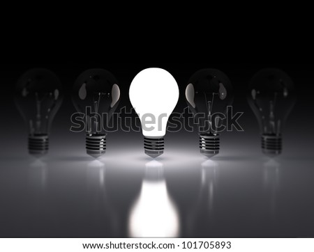 row of light bulbs one lit