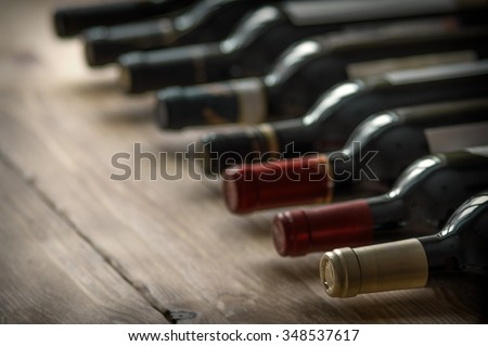 Row of wine bottles. Low depth of field.