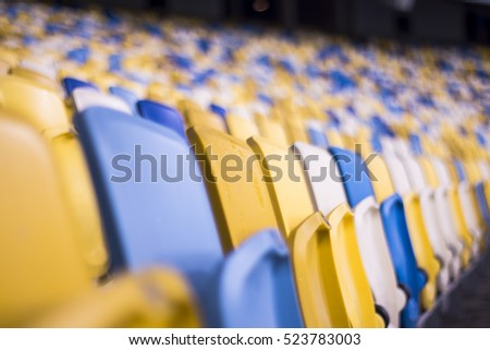 Rows of empty blue seats with the numbers