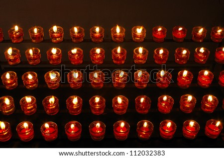 Rows of tealight candles in church, elevated view