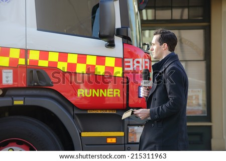 ROZELLE, AUSTRALIA - SEPTEMBER 4, 2014; ABC News Reporter at the scene  of a tragic accident in Rozelle after a suspicious shop explosion claimed the lives of three people and inured others.