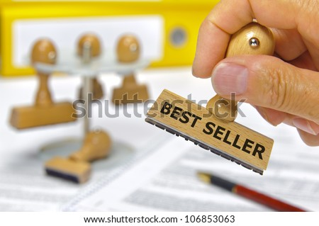 rubber stamp in hand marked with best seller