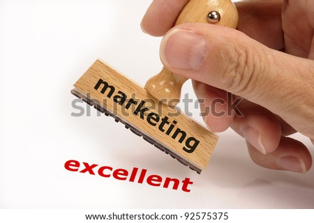 rubber stamp marked with marketing in hand and its copy excellent