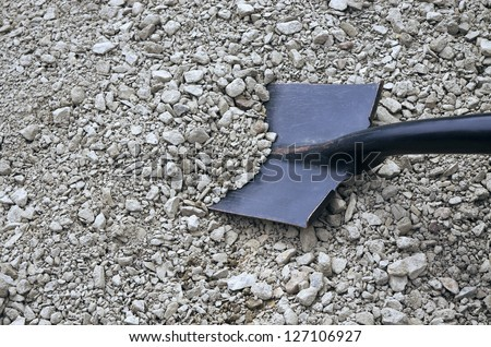 rubble and a black shovel