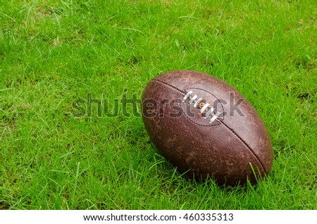rugby ball on rugby pitch grass with copy space