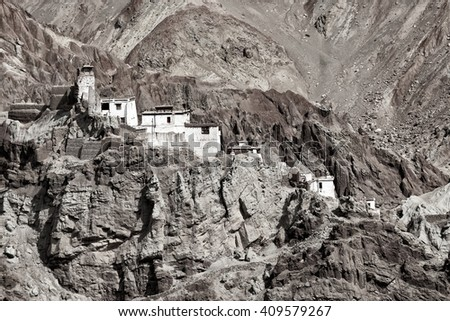 Ruins and Basgo Monastery surrounded with stones and rocks , Leh, Ladakh, Jammu and Kashmir, India , black and white image, tinted.
