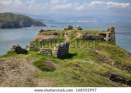 Ruins of Azkorriaga fortress on the coast of the Bay of Biscay, Spain, Basque Country