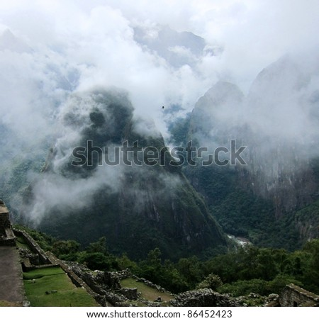 Ruins of Machu Picchu in morning mist, near Cuzco, Peru