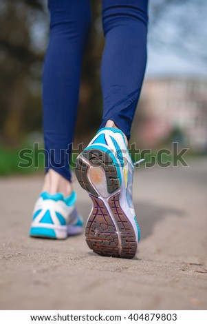 Runner feet running on road.Close up of sport shoes