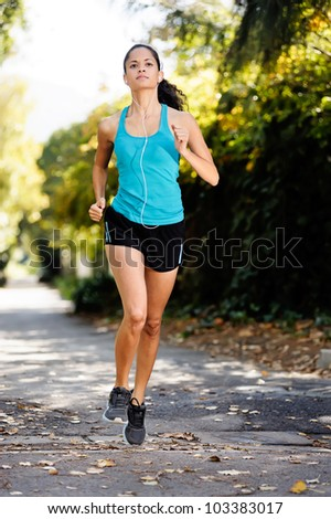 running healthy fitness woman training for marathon outdoors in alleyway. vitality lifestyle run