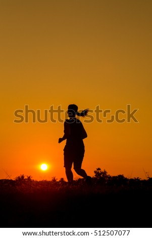 Running man and woman silhouette in sunset time in Thailand Asia