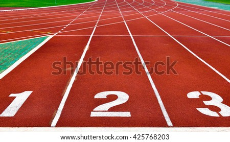 Running tracks with white start numbers