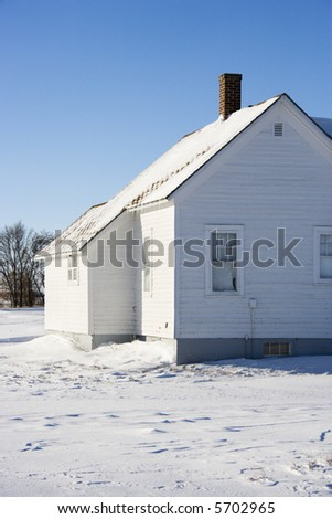 Rural house in snow.