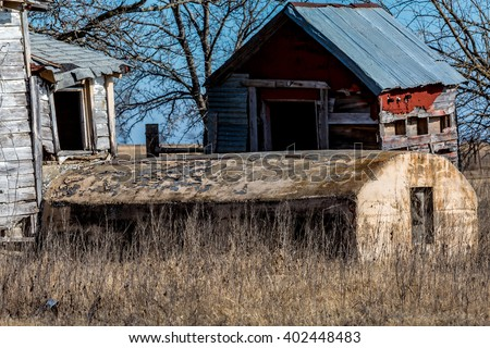 Rural Oklahoma Farmland with Abandoned Barn or Farm House and Storm Shelter