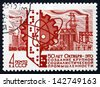 RUSSIA - CIRCA 1967: a stamp printed in the Russia shows Industrial Progress, Computer Tape, Atom Symbol, Cogwheel and Factories, circa 1967 - stock photo