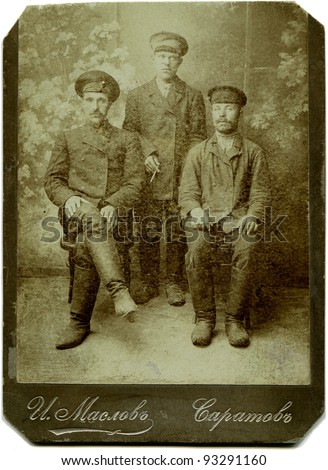 RUSSIA - CIRCA end of the XIX - the beginning of XX century: Three railway workers, Saratov, Russian Empire Russian text: Maslov (name of photographer), Saratov