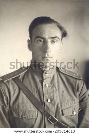 Russia - CIRCA 1946: studio photo portrait of a Captain of the Soviet Army.