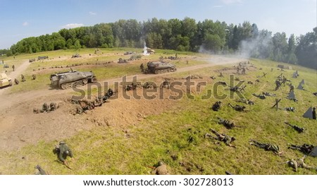 RUSSIA, NELIDOVO -?? JUL 12, 2014: Trenches with German soldiers and red army attack during reconstruction Battlefield at Second World war. Aerial view. (Photo with noise from action camera)
