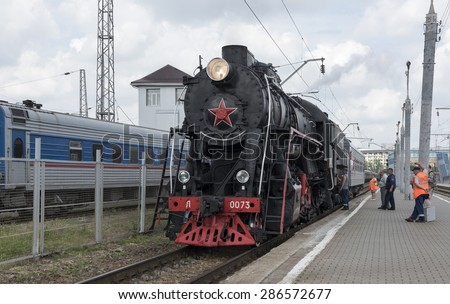 RUSSIA; ROSTOV-ON-DON - MAY 31 - The locomotive is serviced by a brigade of machinists on May 31,2015 in Rostov-on-Don