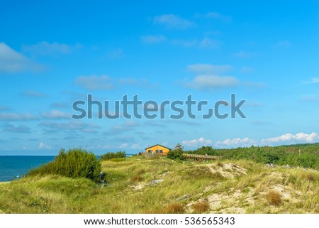 "RUSSIA, VILLAGE of ""MARINE""- August, 2016: the Curonian spit. Sandy beach"
