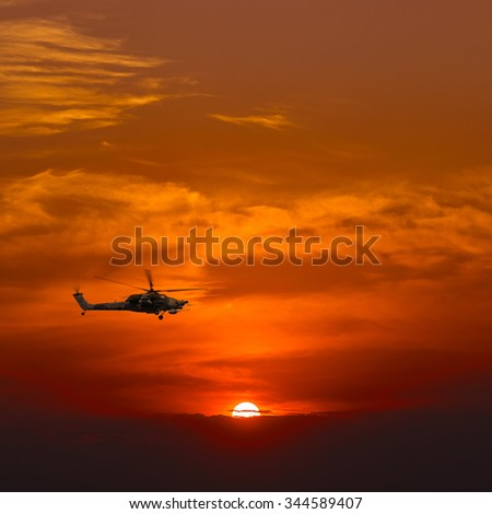 "Russian Combat helicopter Mi-28 ""Havoc"" against the sunset"