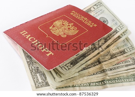 Russian international traveling passport and money over white background. Not isolated.