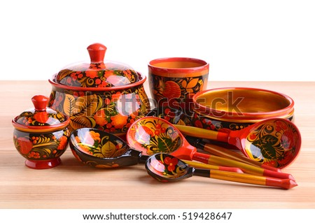 Russian khokhloma, traditional wood painting handicraft souvenirs on a white background. Appeared in the second half of the 17th century in the Nizhny Novgorod.
