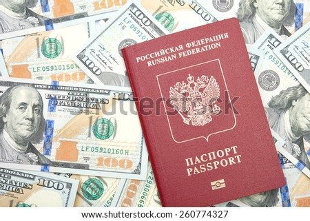 Russian passport with American dollars