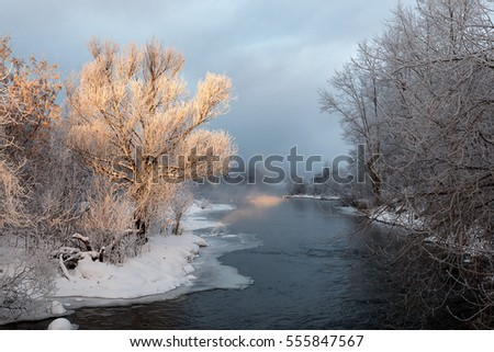 Russian River shore in winter covered with snow