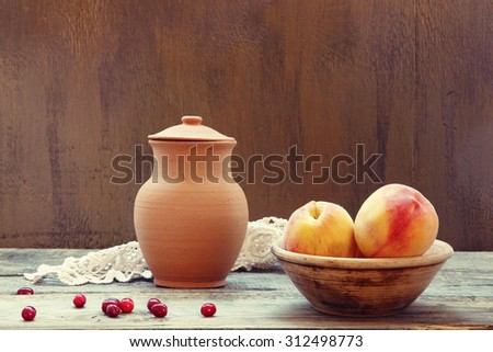 Rustic style still life with ripe peaches