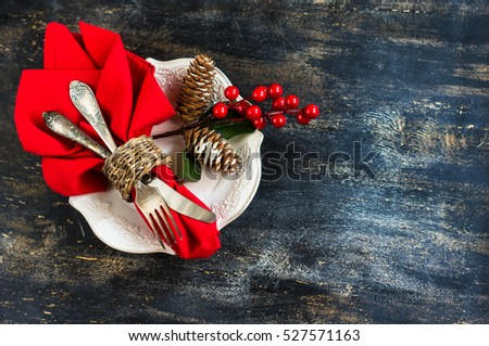 Rustic table setting for Christmas eve on rustic dark table