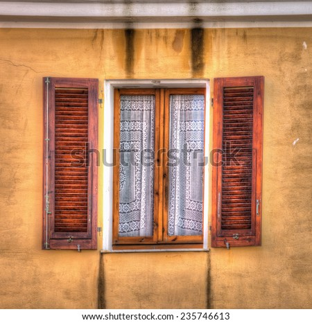 Spanish style window shutters coconut shell stock photo for Spanish style interior shutters