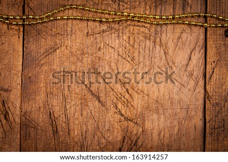 Rustic wooden background with golden pearls above