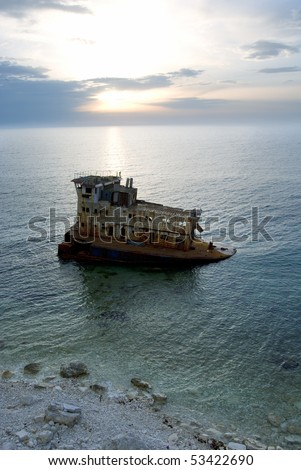 Rusty industrial ship near the coastline. Crimea