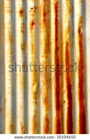Rusty metal wall with grooves.