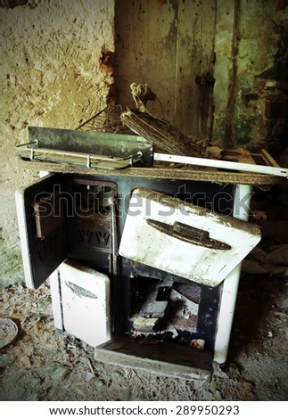 Rusty wood stove of old kitchen in an old abandoned house