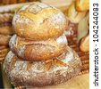 Rye round freshly baked bread at bakery. - stock photo