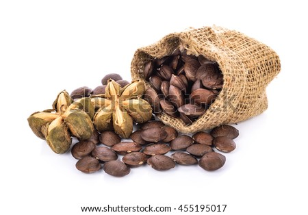 sacha inchi, sacha mani or star inca peanut seed on white background