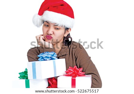 Sad and lonely lady with santa hat and gifts. Isolated in white background.