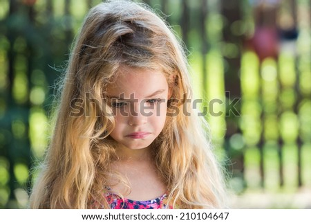 sad little girl with blond hair