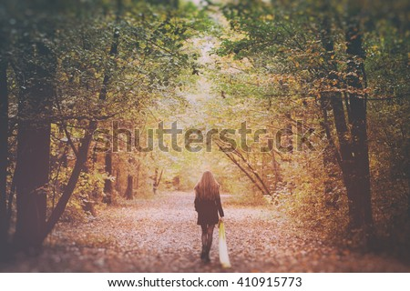 Sad Lonely Woman Walking Away into the Autumn Forest