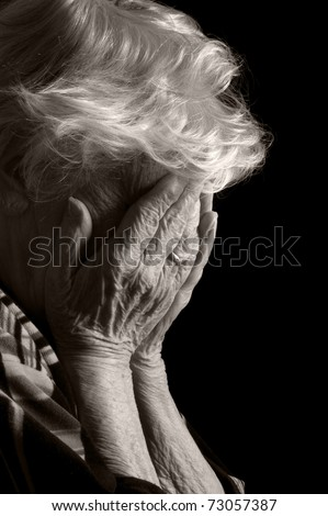 Sad Old Women with her hands to her face is dismay