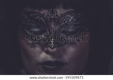 Sad, portrait of woman with black mask thread Venetian