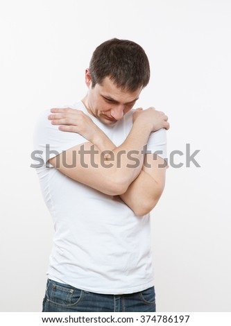 Sad young man inclining his head, white background