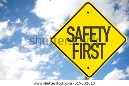 Safety First sign with sky background